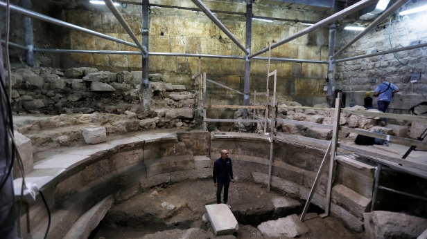 Israel Antiquities Authority archaeologist Dr. Joe Uziel stands inside a theatre-like structure during a media tour to reveal the structure which was discovered during excavation works underneath Wilson's Arch in Jerusalem's Old City