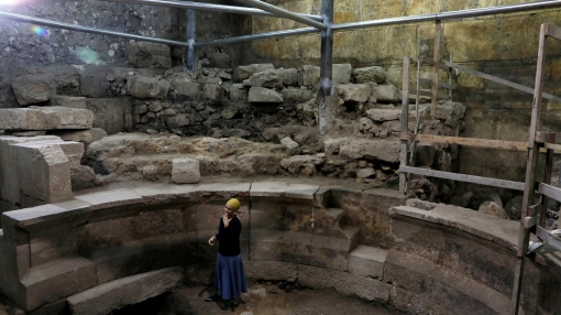 Israel Antiquities Authority archaeologist Tehillah Lieberman stands inside a theatre-like structure during a media tour to reveal the structure which was discovered during excavation works underneath Wilson's Arch in Jerusalem's Old City